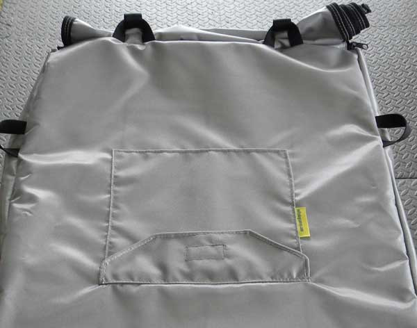 "Accessory ""pocket"" with Velcro closure sewn into cover top."