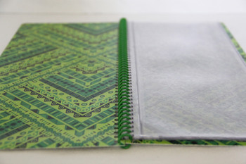 Printed spiral menu with pockets showing open view.