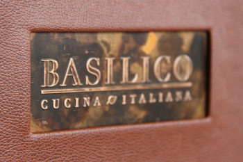 Embossed logo on copper menu cover.