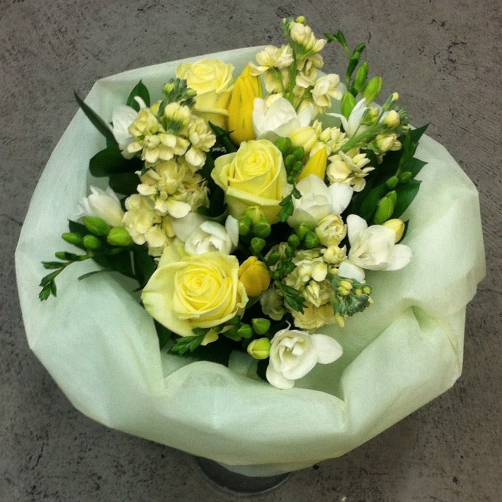 """A lemon and white bouquet based on our best seller """"lambton"""" includes freesias, roses and stock"""