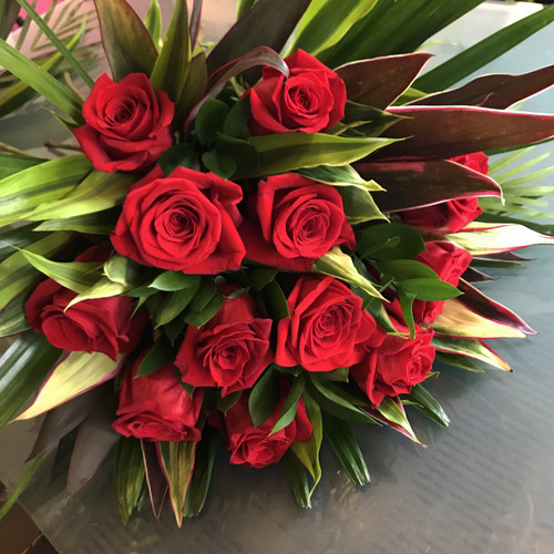 12 Roses, wrapped in the colour of your choice.