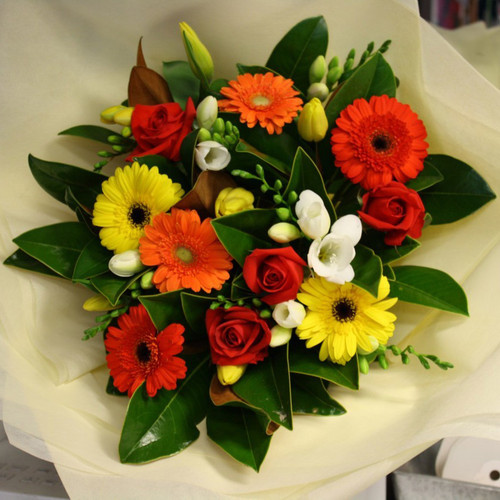 A fresh bouquet of yellows, oranges and whites.