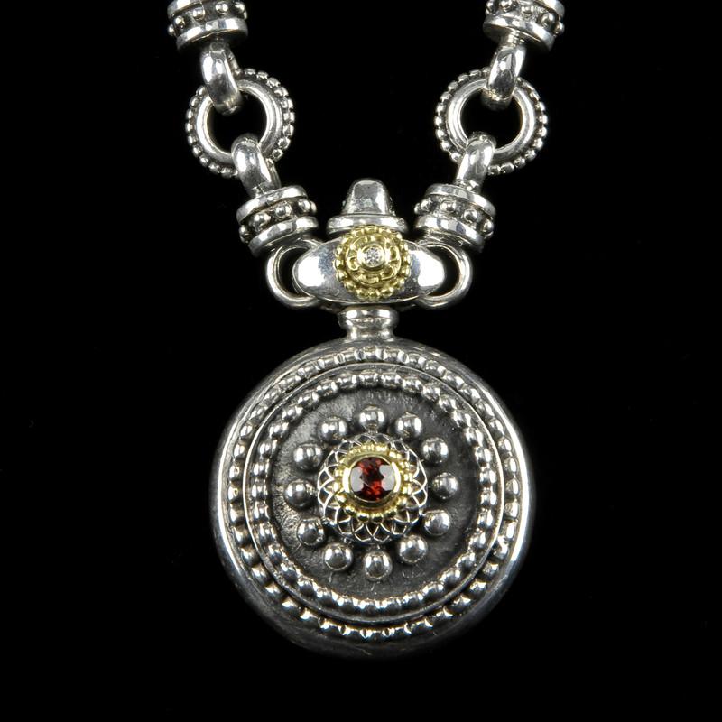 Sundial Necklace handmade in Silver, Gold, Diamond, Garnet by Bowman Originals, Sarasota, 941-302-9594.