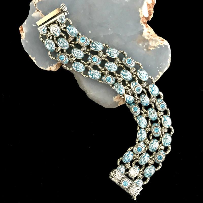 Sterling Silver, Swiss Blue Topaz, Enamel Bracelet handmade by the artisans at Bowman Originals, Downtown Sarasota, 941-302-9594.