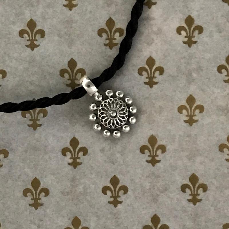 Handmade Sterling Silver Beaded Flower Pendant on Silk Cord by Bowman Originals, Sarasota, 941-302-9594.