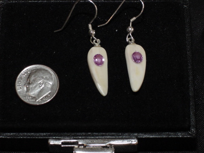 Unique, Alaskan Native crafted ivory with natural pink oval sapphire gems as the focal point in this petite earring set