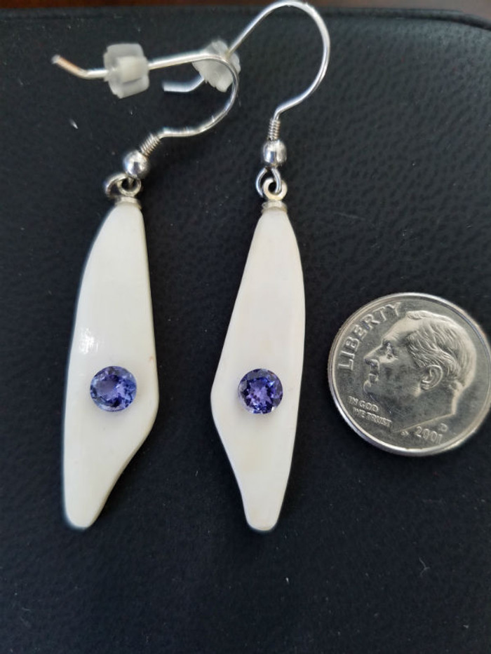 Alaskan Native crafted ivory with a sparkling round purple/blue natural Tanzanite as center stones of earring set