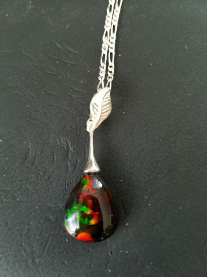 Stunning Alaskan Native crafted Gemstone Pendant created from a finely cut Australian Black Opal to make this uniquely stunning piece of Fine Jewelry for all occasions