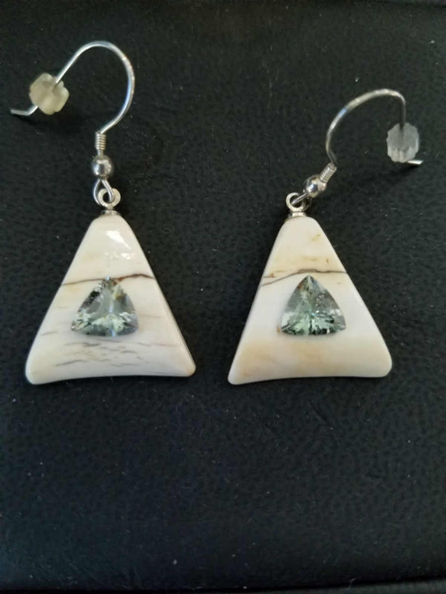 Alaskan Native crafted ivory with Trillion shaped natural Tanzanite as center stone of earring set