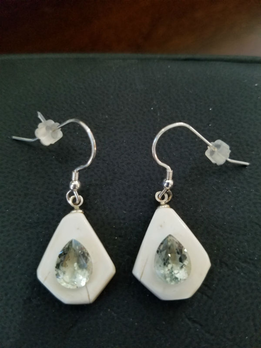 Alaskan Native crafted ivory with pear cut natural green Beryl as center stones of this stunning earring set