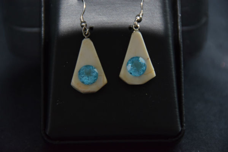 Alaskan Native crafted ivory with round Blue Topaz as center stones of this stunning earring set