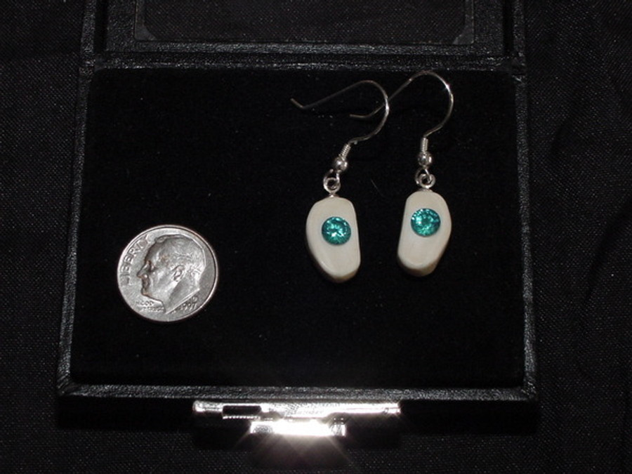 Alaskan Native crafted ivory with a lab-created, round shaped, beautifully faceted teal blue diamond as center stones of this unique earring set