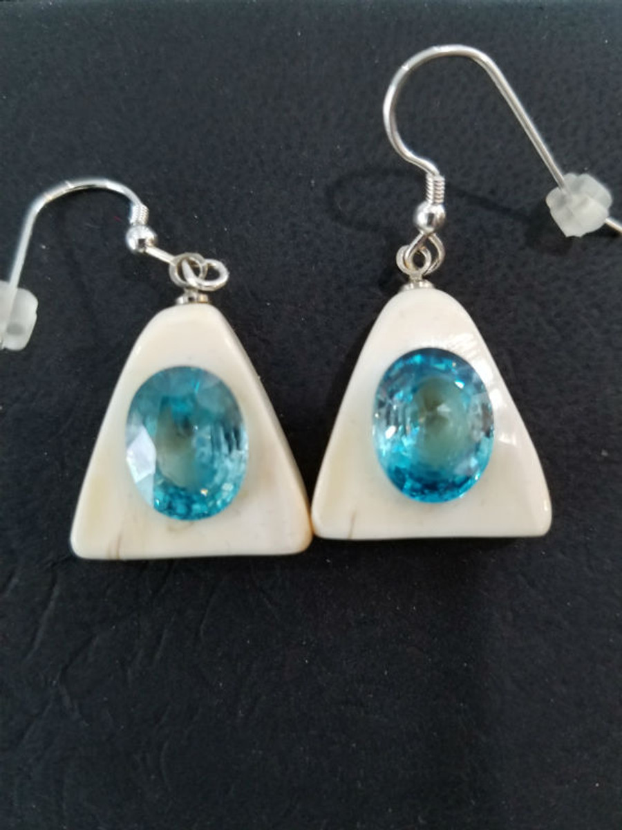 Stunning Alaskan Native crafted ivory with natural Cambodian Blue Zircon oval cut gems in unique earring set