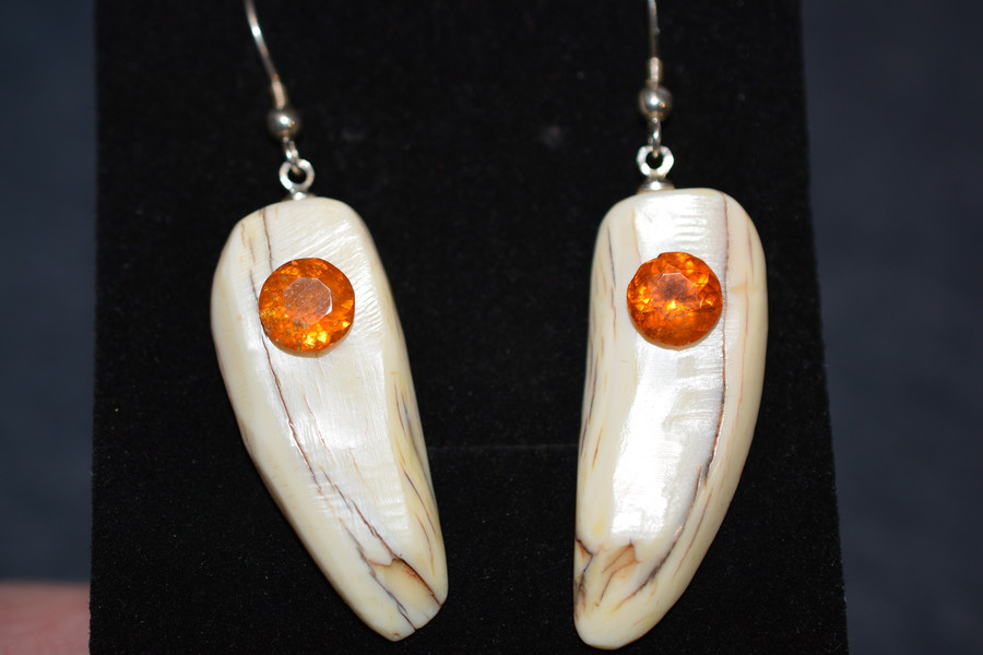 Beautiful, Alaskan Native crafted ivory round, natural Clinohumite as the focal point for this one of a kind, earring set
