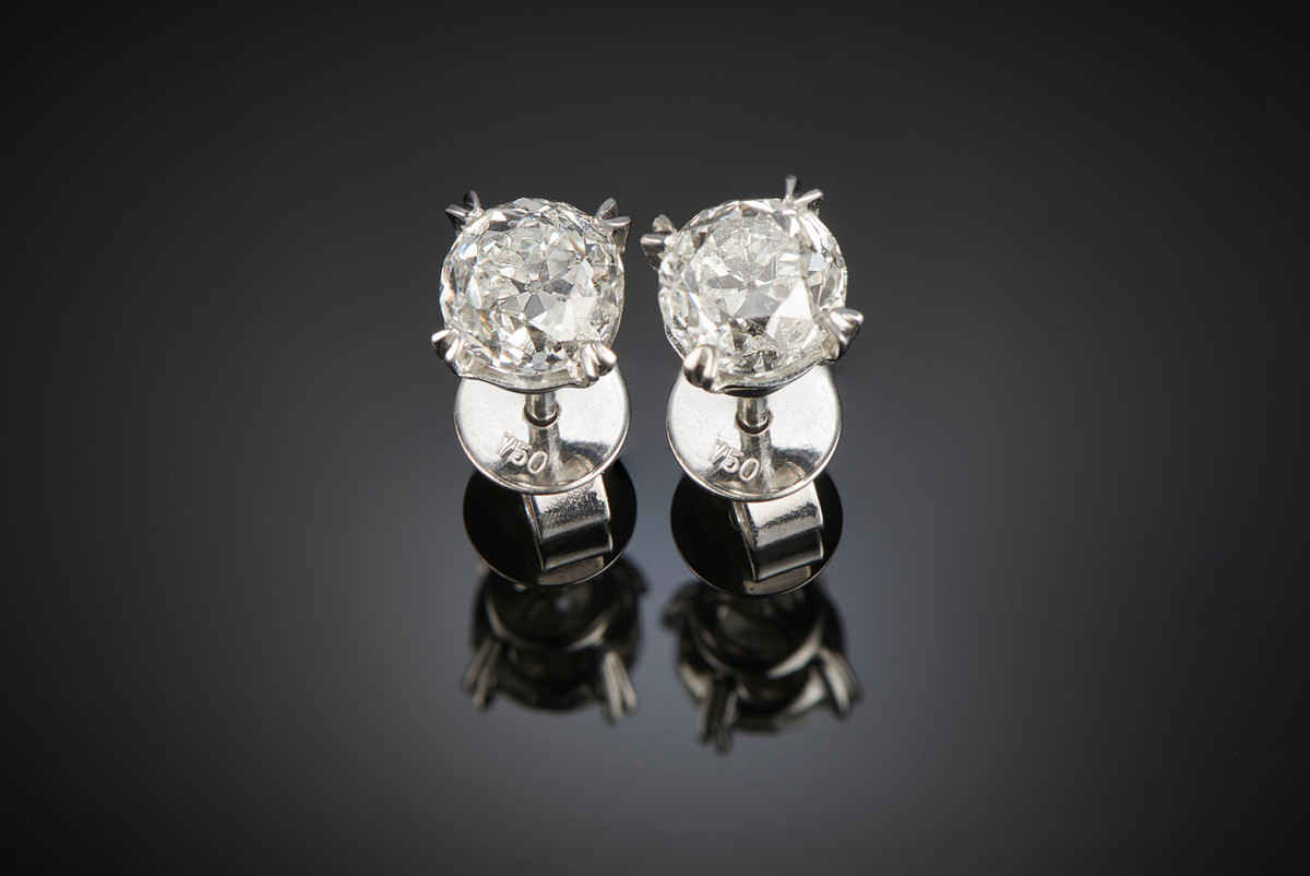 A  Classic Pair of Diamond Stud Earrings. Each stud with one old brilliant cut diamond. Total weight of diamonds: 1.86cts. 18ct white gold setting.