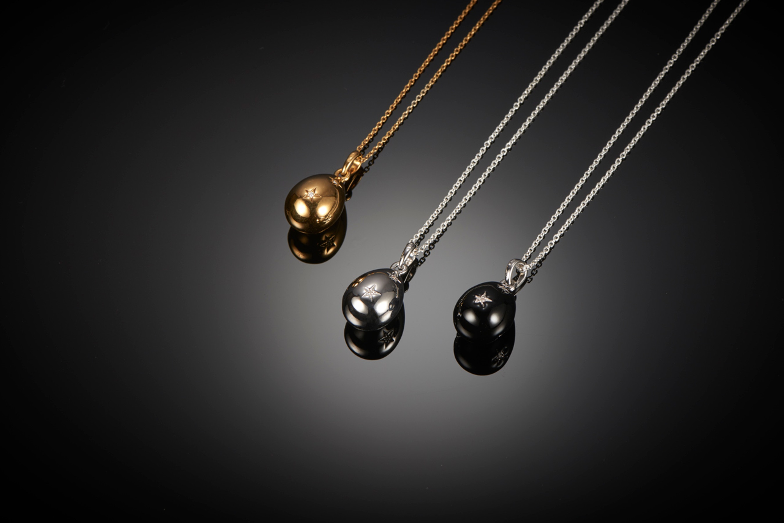 Kozminsky Egg Pendant. Made exclusively for Kozminsky.  Silver with diamonds: $475    Gold plated with diamonds: $475  Black enamel with diamonds: $495