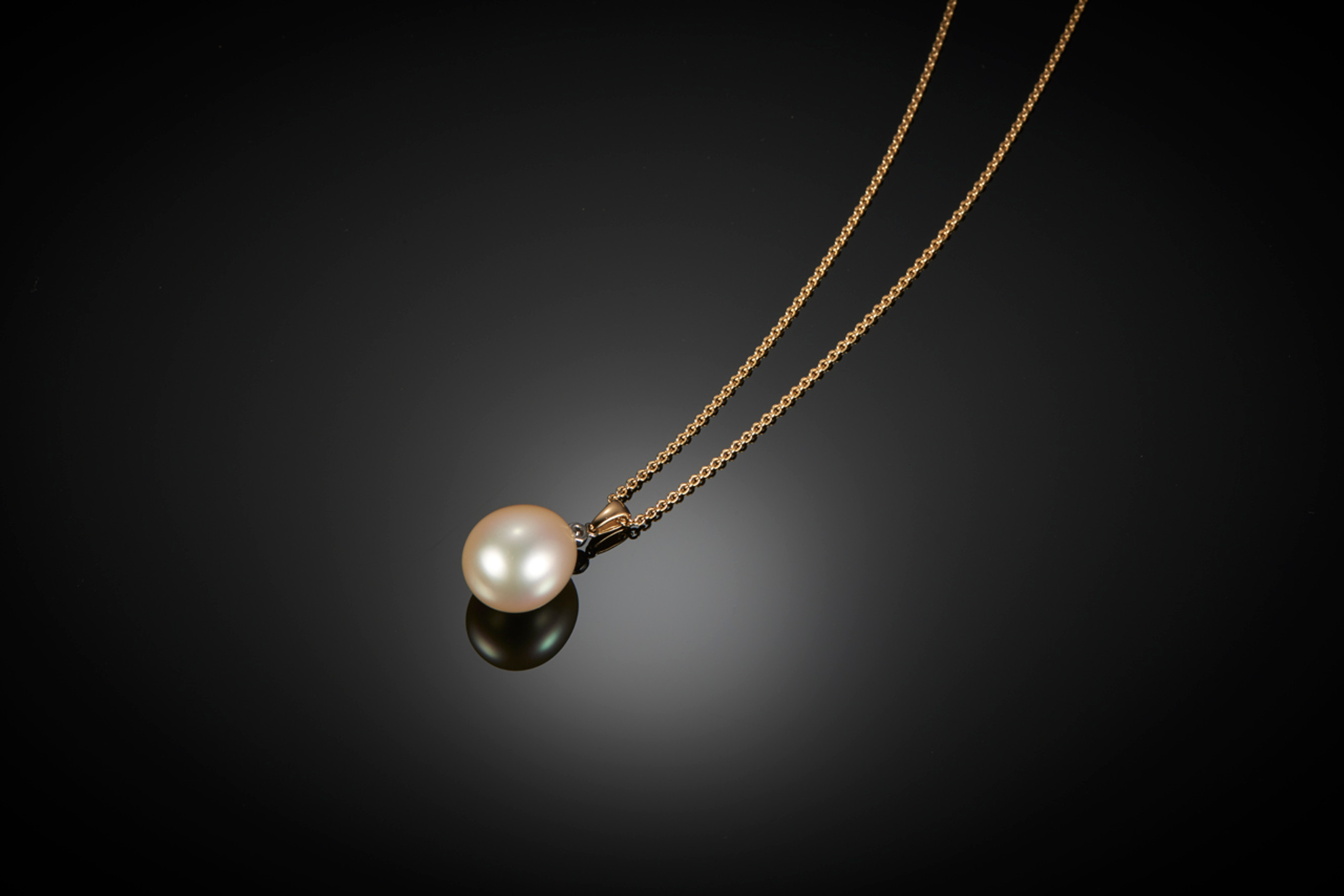 Oval South Sea Pearl and Diamond Pendant. A rare egg shaped pearl with diamond top and gold bale. Pearl size: 16.5mm x 14mm Diamond weight: 0.07cts  Tracelink chain: 50cm, 18ct yellow gold, 4.53gms