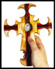 At the back of  the cross is a smooth dent so your fingers will be comfortable in holding the cross.