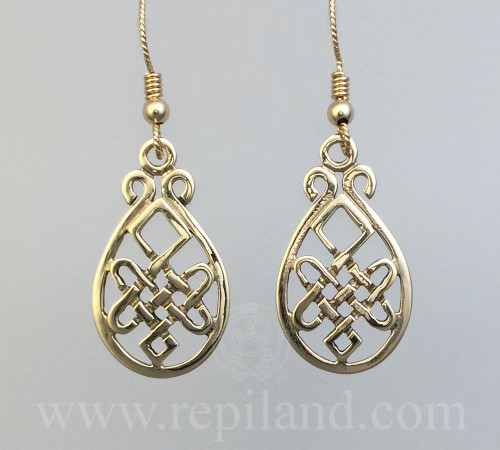 Nerys Earrings with intricate knotwork inside a teardrop shape frame.