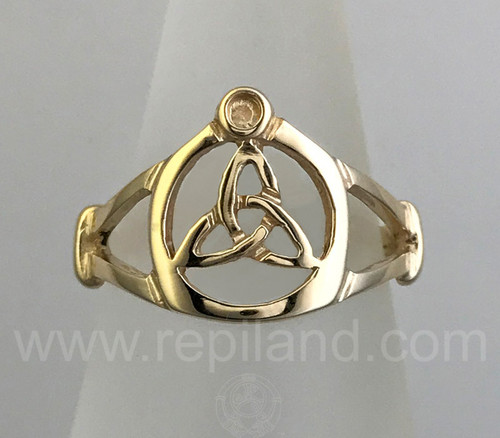 The Annest Ring features a triskele inside a circle.