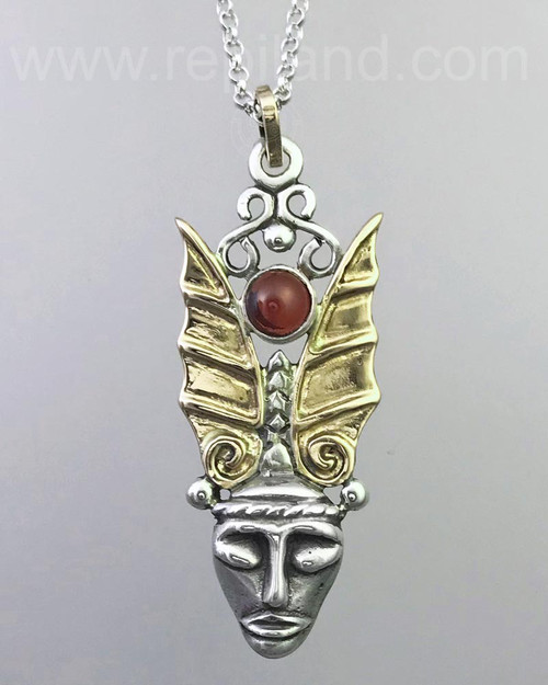 Primitive face topped with spread wings and a 6mm gemstone.