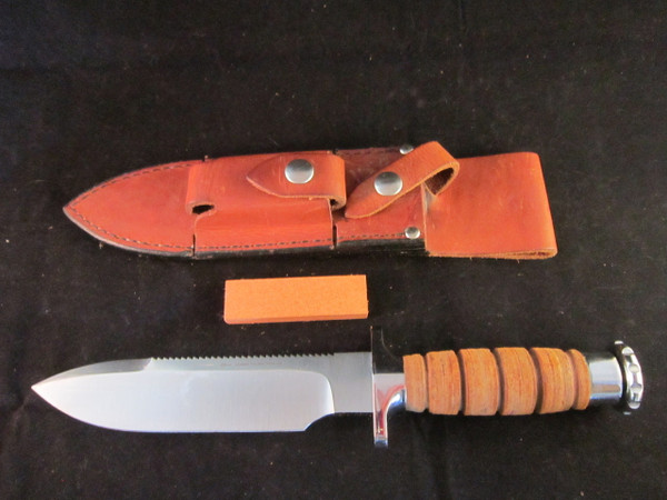 Hackman survival knife with Sheath and stone.