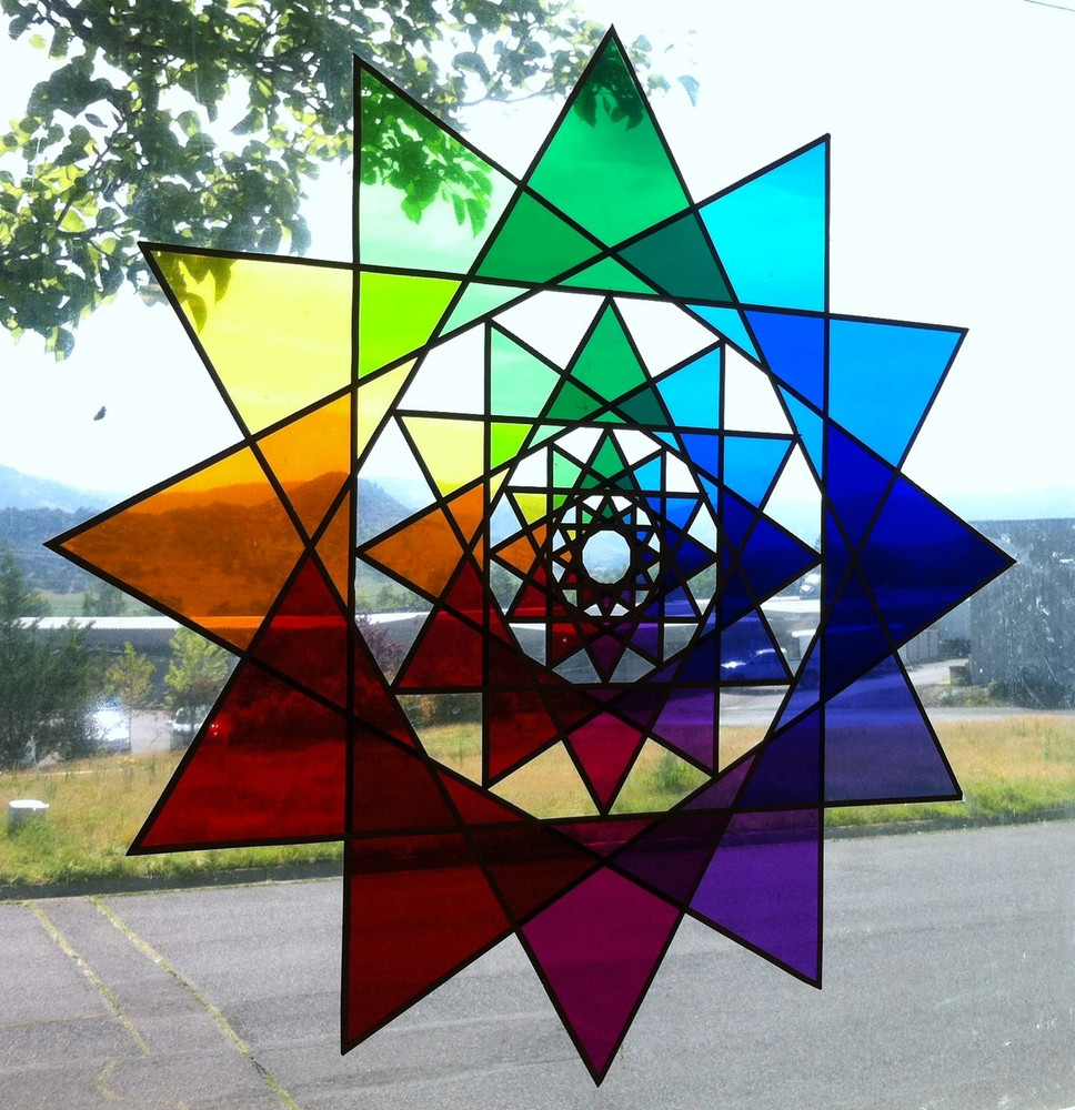"""28"""" Global Earth Star with theater gels on plexiglass"""