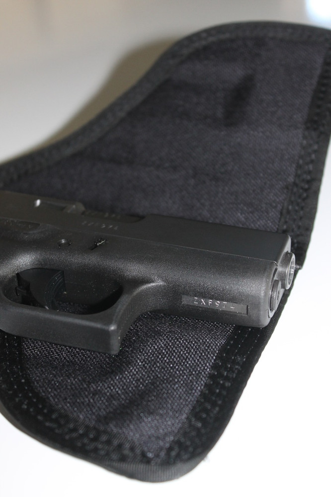 Cutaway PocketPac Pro showing the closed cell foam and Cordura interior formed to the specific gun.