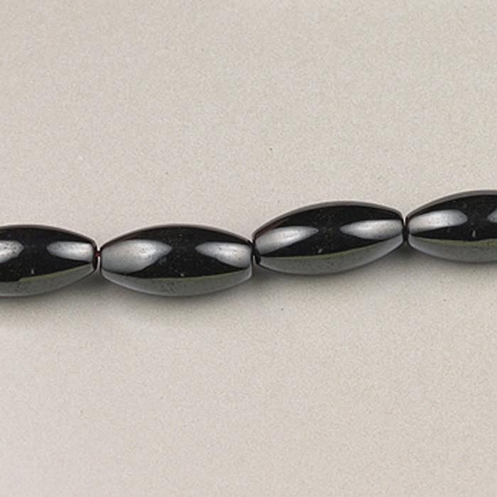 H031 - 6x12mm Melon, Hematite (16 in. strand)