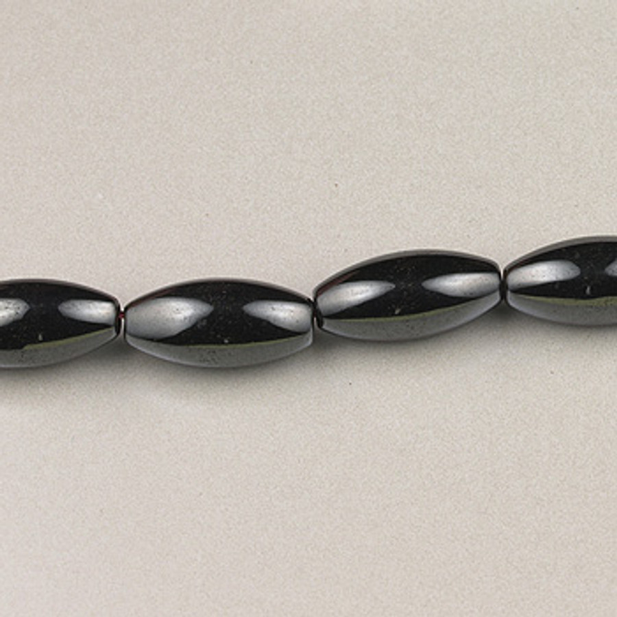 H031 - 6x12mm Melon, Hematite (16 in. strand)