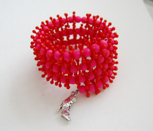 Funky red and pink wrap bracelet with a boot charm