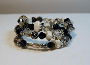 Black crystals, semi precious stones and clear crystals wrap bracelet