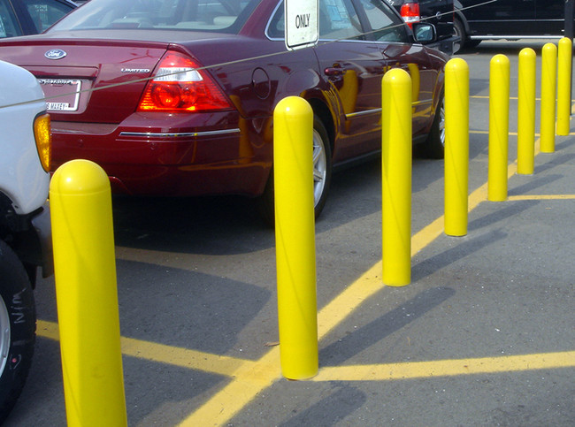 Comparing the Cost of Painting Bollards and Plastic Bollard Covers