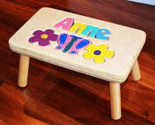 Butterfly and Flower Puzzle Name Stool, shown with jewel letters