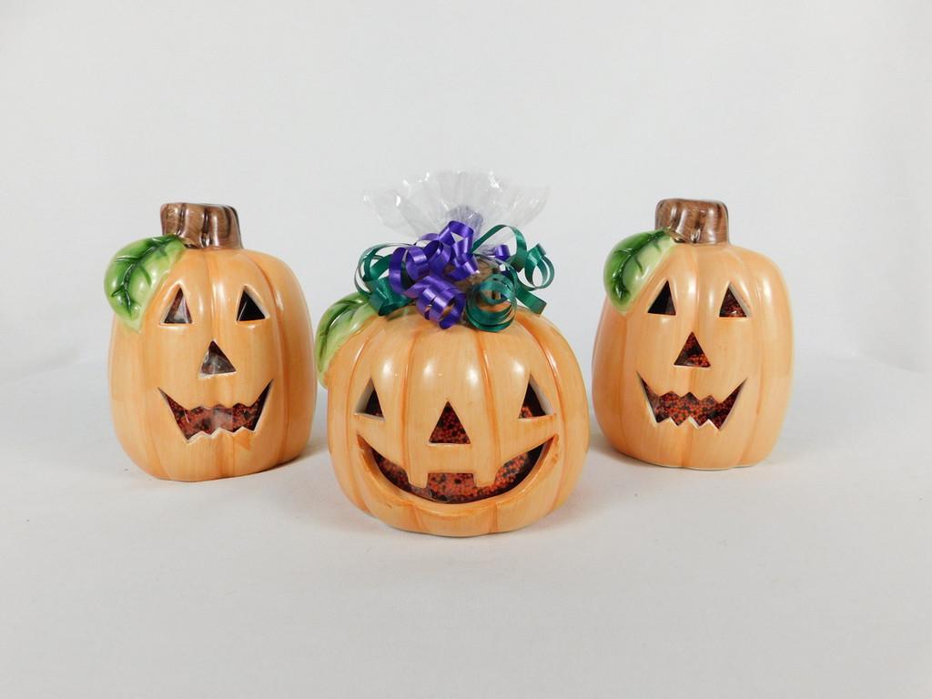 This Ceramic Pumpkin Candle Holder contains, 6oz. chocolate covered mini pretzel.