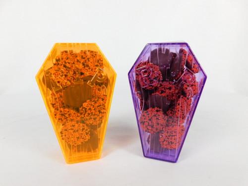 This Plastic Coffin contains, 6oz. non-pareils