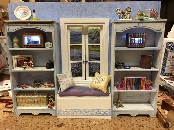 Window seat kit is shown in this roombox.  Thank you to Kathy Novak for letting us use this photo.  Shelves shown are also kits made by us.  Sold as here:  http://www.grandpasdollhouse.com/shelf-kit/