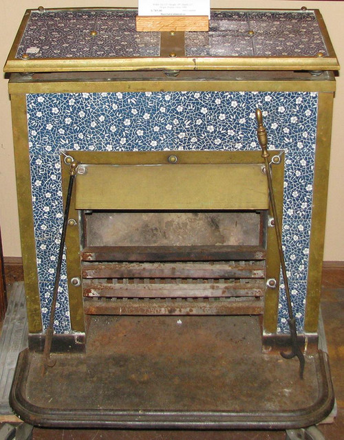 Rare antique heating stove made from cast iron, brass and covered in floral blue & white tiles.