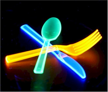 Fluorescent plastic spoons glowing under ultra violet light