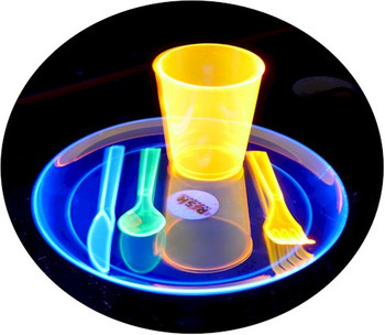 Neon black light plates, knives, cups, and forks that glow under UV light