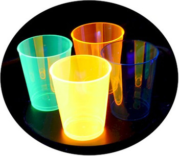 Plastic UV  cups glowing under ultra violet light