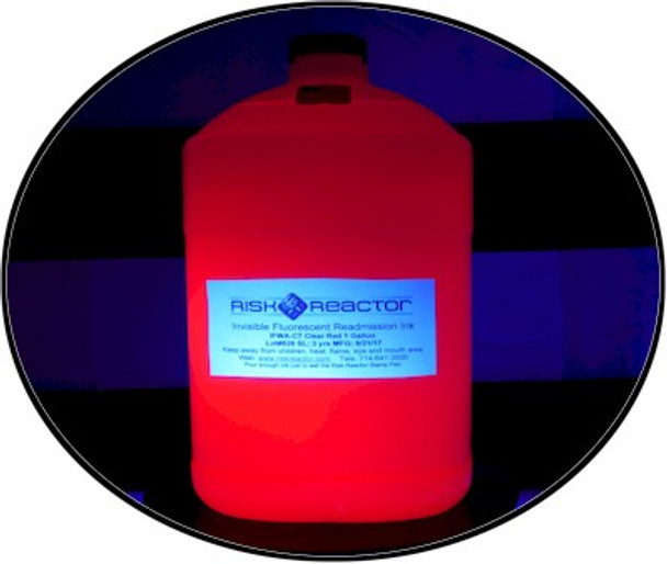 UV fluorescent red ink gallon under black light glowing brightly.