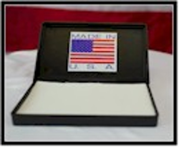 The American made PAD1 stamp ultra violet ink pad is open showing the felt quality pad.