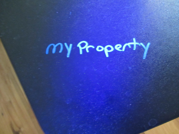 My property is marked with the black light marker MAX-C0 using invisible fluorescent ink.