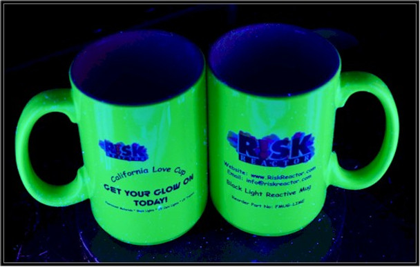 Fluorescent lime green coffee cups under black light illumination