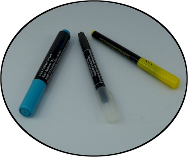 Picture of three pens all write with fluorescent invisible blue ink