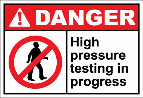 Danger Sign high pressure testing in progress