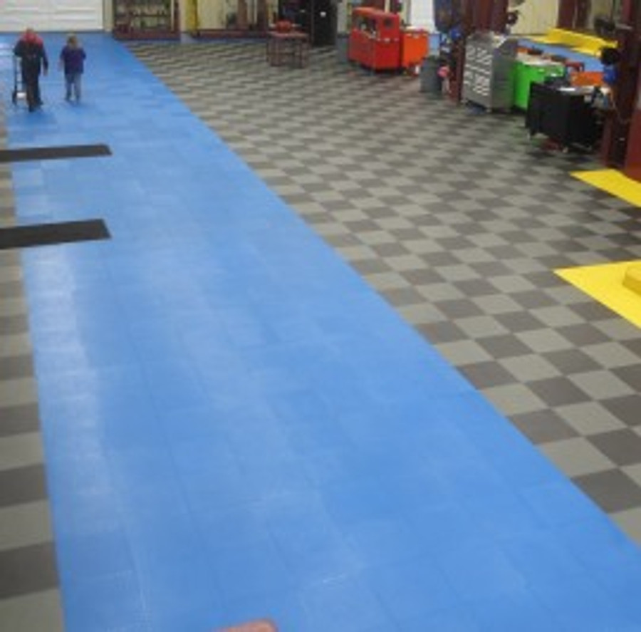 Perfection Floor Tile Flexi Tile Commerical Smooth Blue tiles in a warehouse