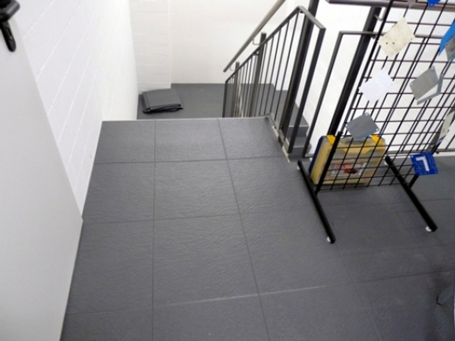 Perfection Floor Tile Homestyle Slate Interlocking Flexibile Tiles, Grey on a stair well.