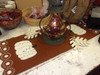 THIS WHITE PUMPKIN TABLE RUNNER IS THE PERFECT TOUCH FOR YOUR FALL TABLE. 36 inches long, and 13 1/2 inches wide.